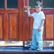 Cute boy at house entrance - Stock Photo