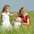 Stock Photo: Happy mother with two children on nature