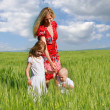Happy family in green field - Stock Photo