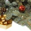 Xmas tree, present box and red ball — Stock Photo