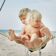 Two kids playing on beach — Stock Photo #12612800