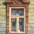 Carved wooden window frame — Stock Photo #12612884