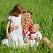 Happy mother with two children outdoors — Stock Photo