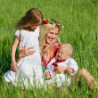 Stock Photo: Happy mother with two children outdoors