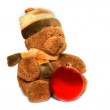 Teddybear with christmas ball over white — Stock Photo