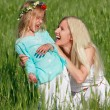 Happy mother and daughter outdoors — Foto Stock