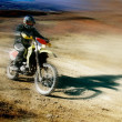 Moto racer in movement — Stockfoto #12613116