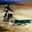 Moto racer in movement — Stock Photo