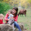 Stock Photo: Mother playing with two kids on nature