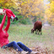 Mother and baby in autumn forest — Stock Photo