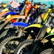 Row of motobikes, close up at wheels — 图库照片