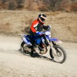 Moto racer in movement — Stockfoto