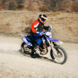 Moto racer in movement — Stock Photo #12614708