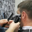 Male barber at work - Stock Photo