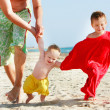 Happy family on beach - Stock Photo