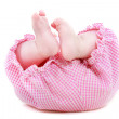 Baby's feet over white — Stockfoto
