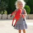 Adorable toddler girl walking outdoors - Stock Photo