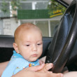 Baby driving a car - Stock Photo