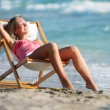 Young girl relaxing on sea background - Stock Photo