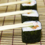 Sushi and chopsticks — Stock Photo #12615359