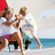 Mother and son on board of sea yacht — Stock Photo