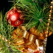 Close up of gift box and xmas tree decoration — Stock Photo