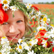 Happy girl in floral wreath on natural background — Stock Photo