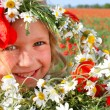 Outdoor portrait of smiling girl with flowers — Stock Photo