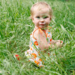 Stock Photo: Cute toddler girl in green grass