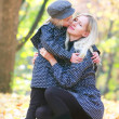 Stock Photo: Loving mother and daugther in autumn park