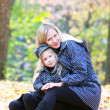 Loving mother and daughter in autumn park — Stock Photo