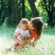 Mother and son outdoors — Stock Photo #12615945