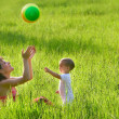 Mother and son playing with colorful ball — Stock Photo