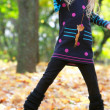 Jumping girl in autumn park — Stock Photo