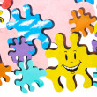 Colorful puzzles painted on stone wall — Stock Photo