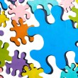 Colorful puzzles over white — Stock Photo