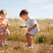 Two kids playing on coutry road — Stock Photo