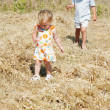 Two kids walking on rural background — Stock Photo