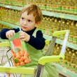 Young boy in supermarket — Stock Photo