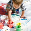 Boy painting over white — Stock Photo
