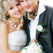 Young happy bride and groom over white portrait — Stock Photo