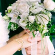Close up of wedding couple hands with bouquet — Stock Photo