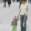 Mother and son walking — Stock Photo #12617640