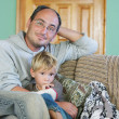 Father and son watching tv at home — Stock Photo #12617707