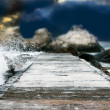 Rocks at stormy sea background - 