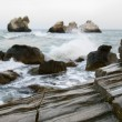 Rocks on stormy sea background — Stock Photo