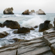 Rocks on stormy sea background - Stok fotoğraf