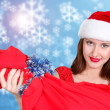 Santa girl on xmas background — Stok fotoğraf