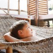 Young boy relaxing in hammock - Stock Photo