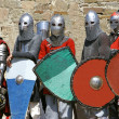 Stock Photo: Several knights on stone wall background